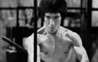 Bruce Lee from Enter the Dragon with Esrkima Sticks.